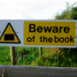 Sign Beware of the Book