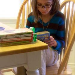 Jerah reading at table